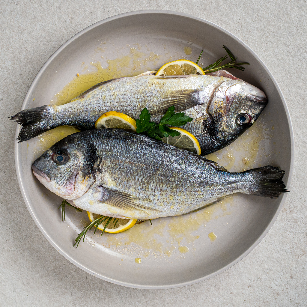 marinated fish in olive oil, rosemary and lemon
