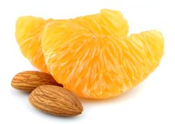 Tangerine segment with nuts on a white background