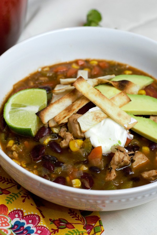 close up chicken tortilla soup in white bowl