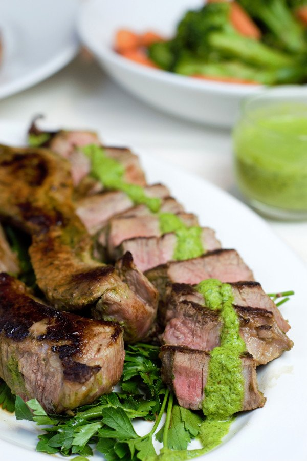 Grilled steak sliced with chimichurri sauce
