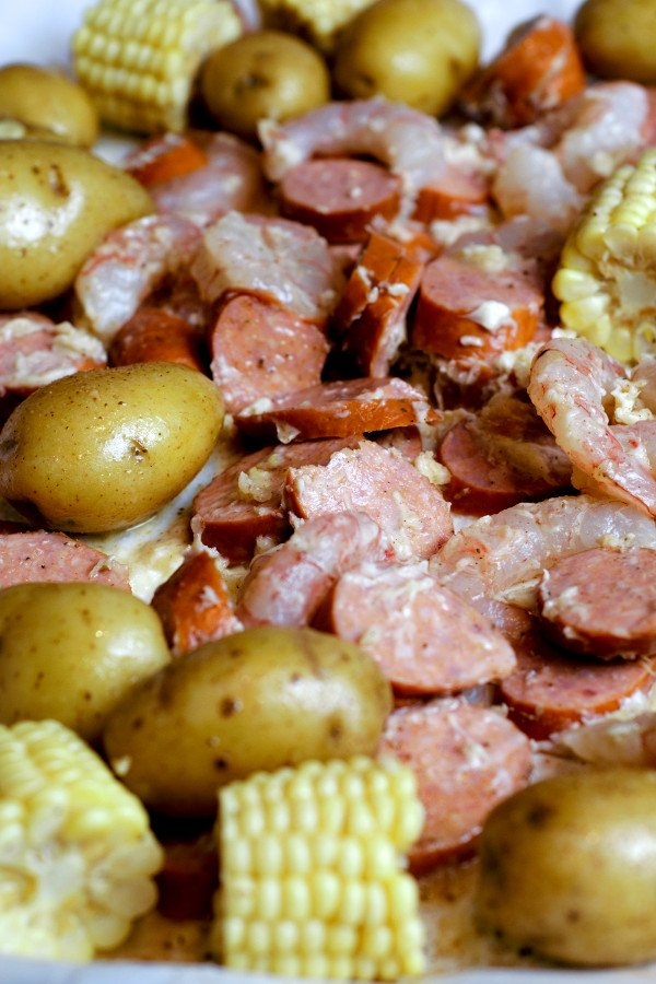 Shrimp, Sausage, Corn, and Potatoes drenched in butter, garlic and Old Bay seasoning. The potatoes are parboiled so they will cook perfectly and take the same amount of time as the shrimp.