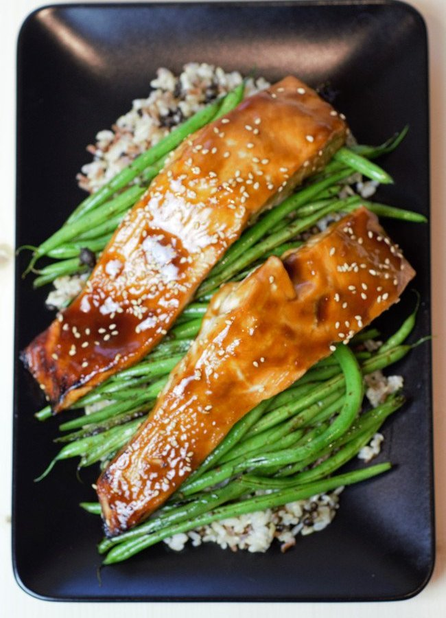 Salmon with homemade teriyaki sauce on green beans and brown rice.
