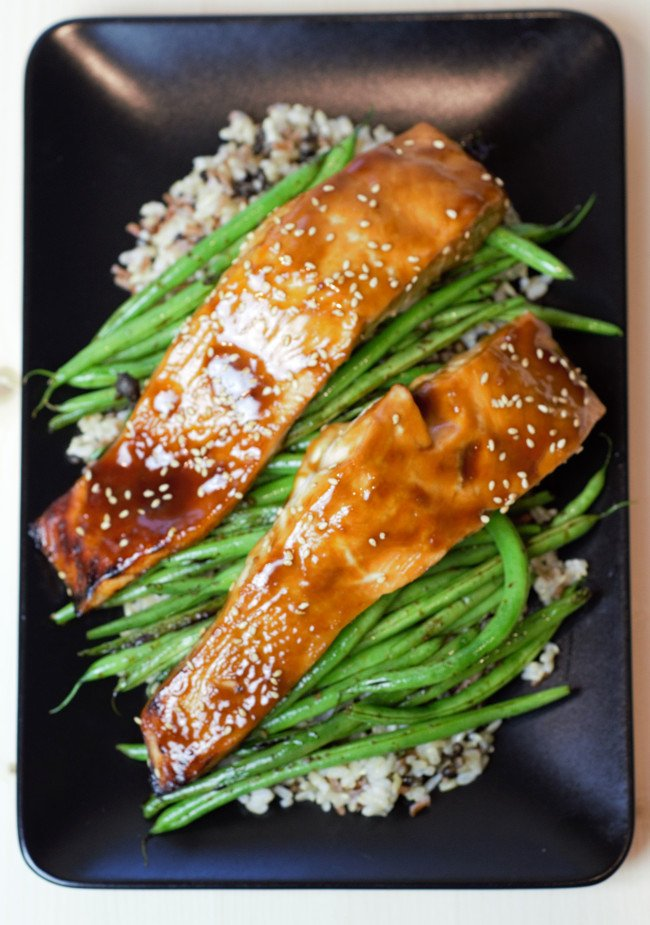 Salmon with homemade teriyaki sauce on green beans and brown rice.