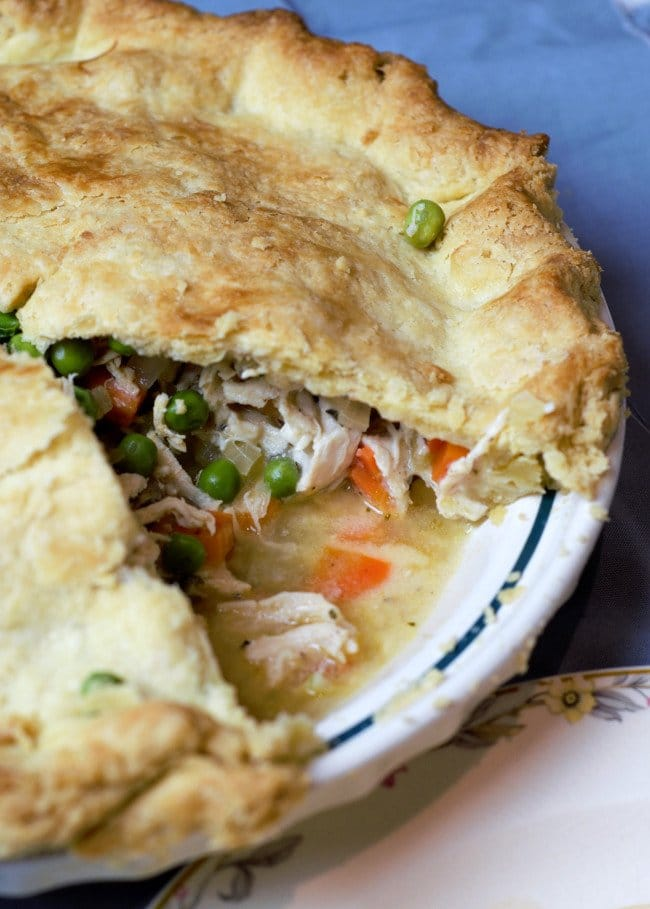 chicken pot pie with a slice taken out to show the chicken and vegetable filling
