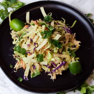 overhead image of thai chicken salad on black plate