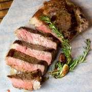 sliced steak on parchment