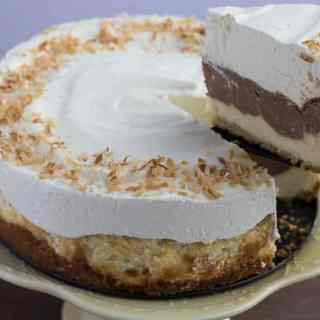 Layered Coconut Chocolate Cheesecake with Almond Crust