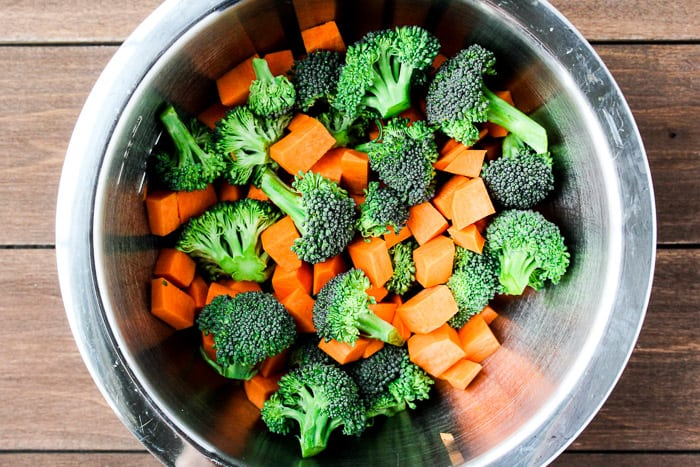 Broccoli and Cubed Sweet Potatoes in a Silver Bowl