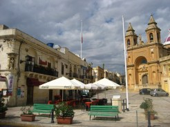 Marsaxlokk's main square with the church and bell tower.