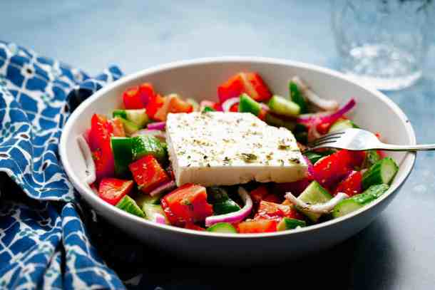 White bowl filled with greek salad