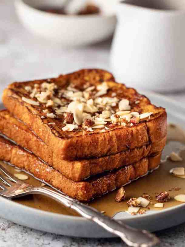 pumpkin-french-toast topped with almonds and maple syrup