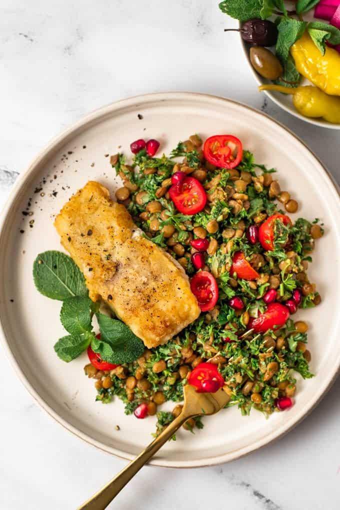 Fried fish with lentil salad