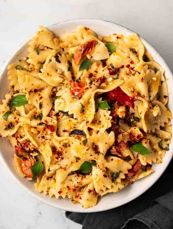 A white bowl filled with creamy baked feta pasta
