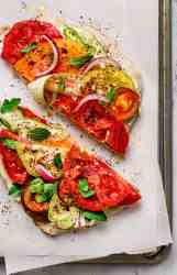 Lebanese Labneh sandwiches topped with heirloom tomatoes