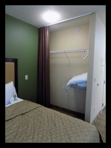 Great Closet Space with extra pillows, sheets and blankets PLUS Ironing board and Iron