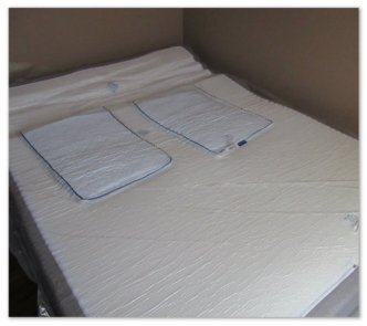 Mattress Unrolled With 2nd Plastic Cover. Underside Of Mattress With The 2 Free Pillows. Once We Removed Plastic & Pillows We Flipped It Over.