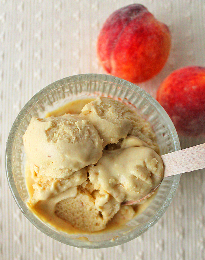 Break our your ice cream machine and make a batch of this vegan Coconut Peach Ice Cream to cool down during the hot summer days.
