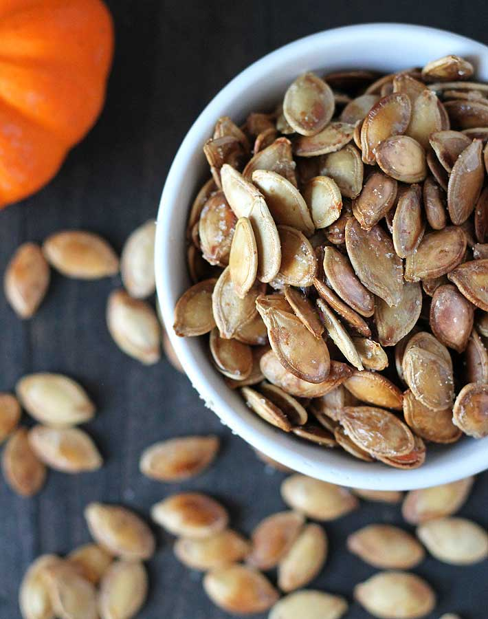 Don't throw those pumpkin seeds away! Follow this step-by-step on How to Roast Pumpkin Seeds and see just how easy. You'll never throw them out again!
