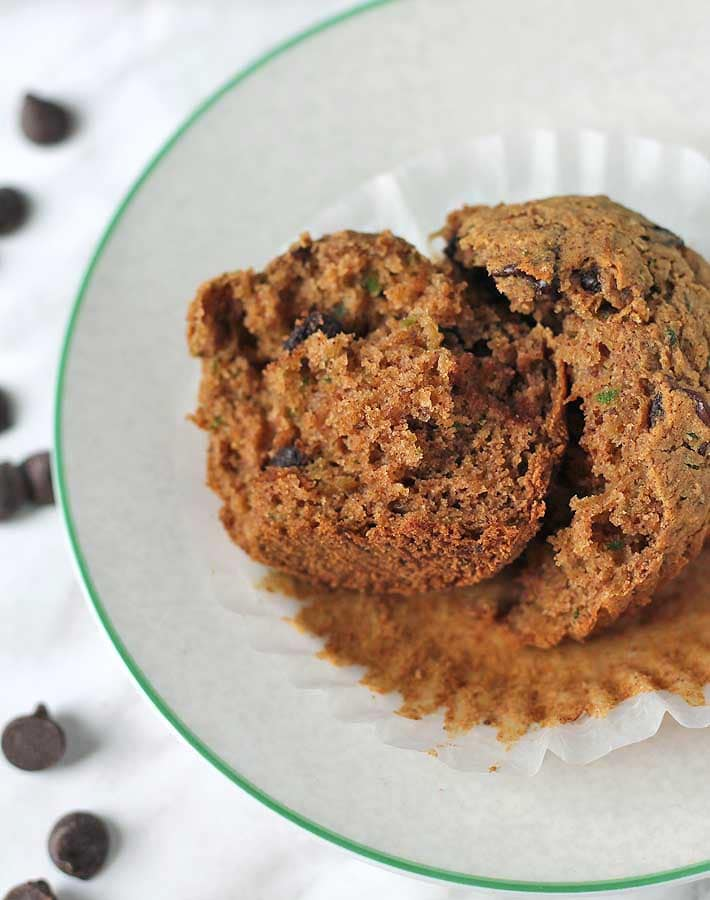 Vegan Gluten Free Zucchini Chocolate Chip Muffins split apart showing inside texture.