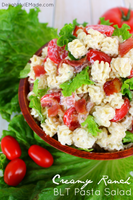 The perfect pasta salad recipe for any potluck, cookout, picnic or back yard BBQ! This amazing side dish is loaded with bacon, tomatoes, crisp green leaf lettuce, and topped with a fantastic creamy ranch dressing. Make extra - this disappears FAST!!