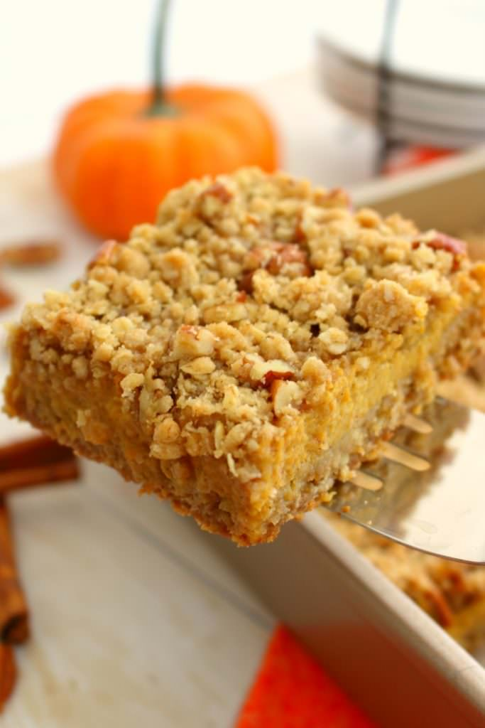 Even easier than pie, these Pumpkin Pie Bars with Pecan Crumble are the perfect fall dessert! Made with a simple oatmeal brown sugar crust, and topped with an amazing pecan crumble, this pumpkin dessert will be even more popular than the classic pie!