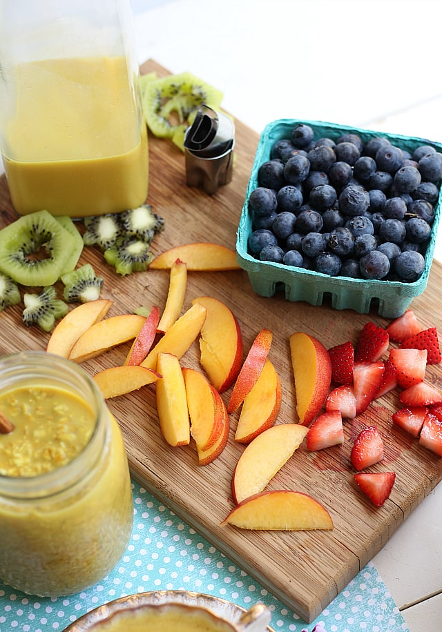 Fresh fruit on oatmeal with honey and turmeric