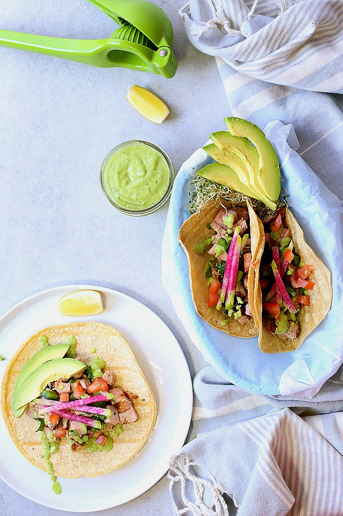 Slow cooker pork tacos slowly cooked in, and then drizzled with zesty green goddess dressing. An easy dinner and meal-prep with left overs that can serve another meal! #slowcooker #crockpot #pork #tacos #healthy #glutenfree #recipe #easy #dressing | delightfulmomfood.com