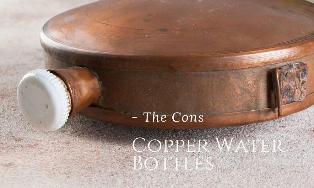 copper flask water bottle on a concrete