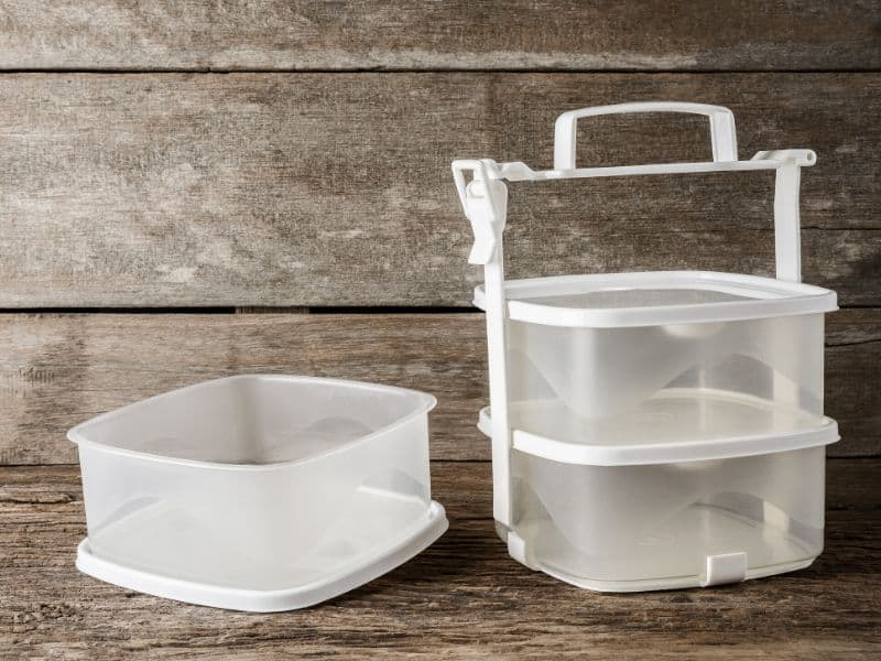 Empty white tupperware containers for food