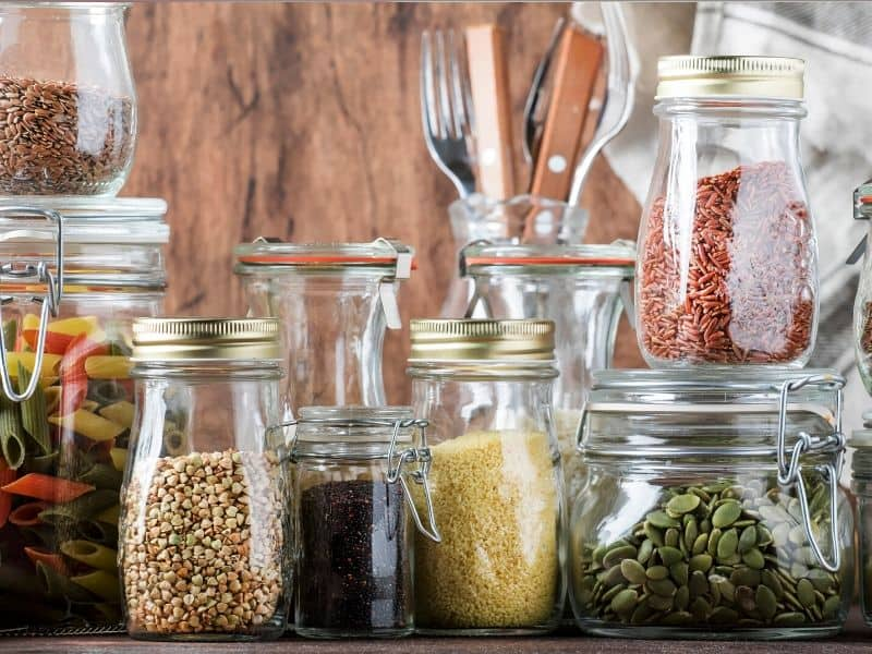 Different Size of Glass Jars fill with useful seeds, cereal and pasta