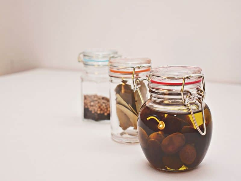 three different size of Glass jar fill with different food
