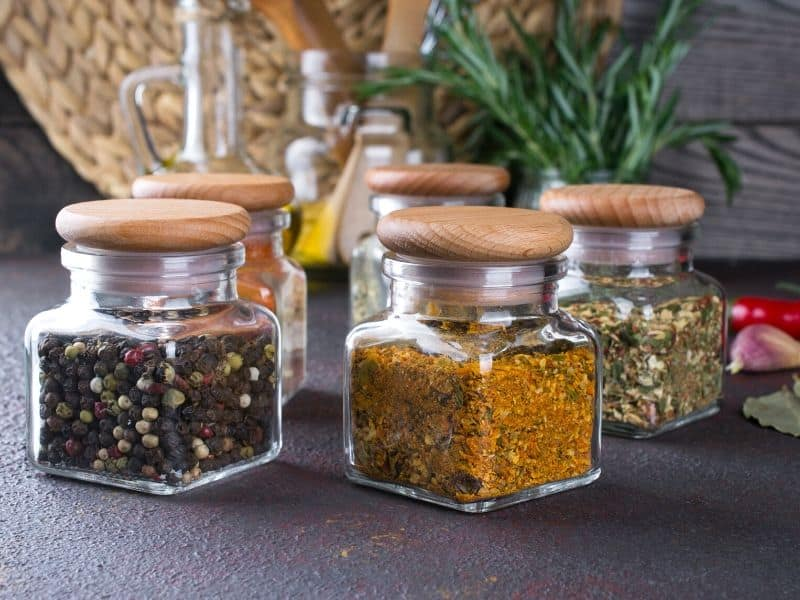 dried spices stored in the glass jar