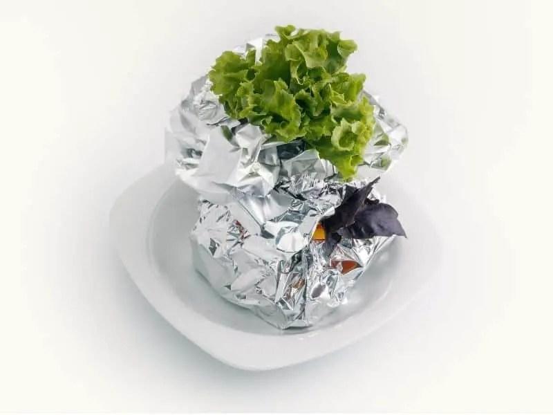 Meat, vegetables, fish baked in aluminum foil