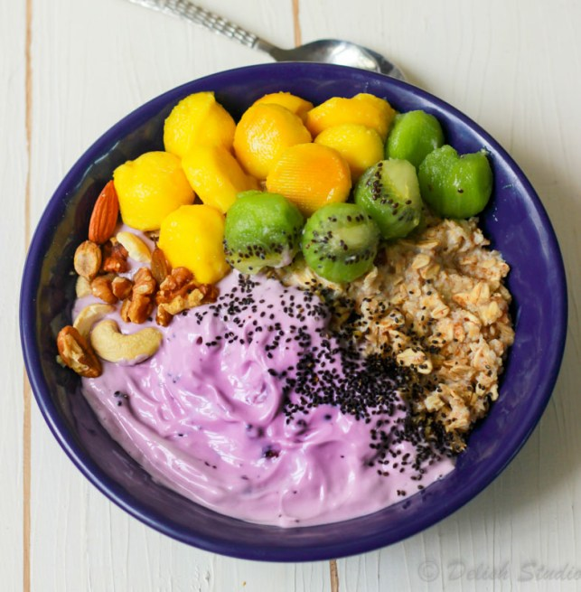 closeup view of easy overnight oats with blueberry yoghurt in a blue bowl