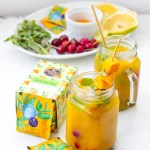 Aam Salaam mango iced tea mocktail side view of ingredients and drinks in 2 mason jars