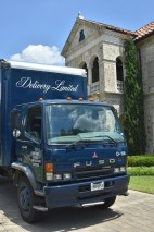 Delivery Limited Truck in front of house