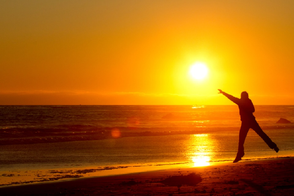 https://www.dreamstime.com/royalty-free-stock-photo-woman-catching-sunset-beach-image21045805