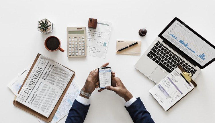 business documents smartphone - 6 Characteristics of the Forex Market You Have to Know