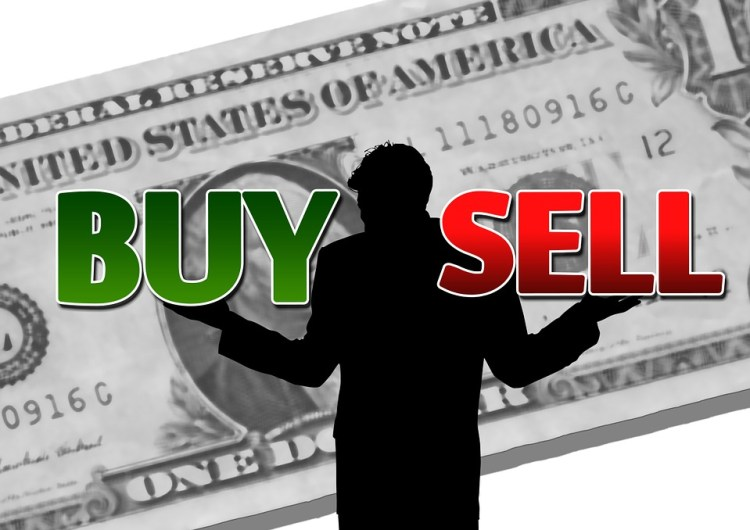 dollar businessman finance buy - Top Tips for Exchanging Currency While Traveling