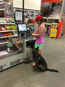 Ash and Scout checking out at Home Depot during a supply run