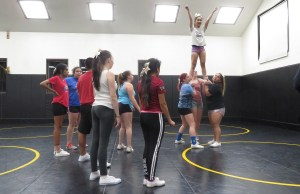 Students in the Delta cheerleading squad practice their stunting. Photo by Vivienne Aguilar.