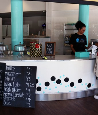 Owner D'lilah Vanessa Pubill serves Delta student at her new business. Photo by Adriana Hernandez