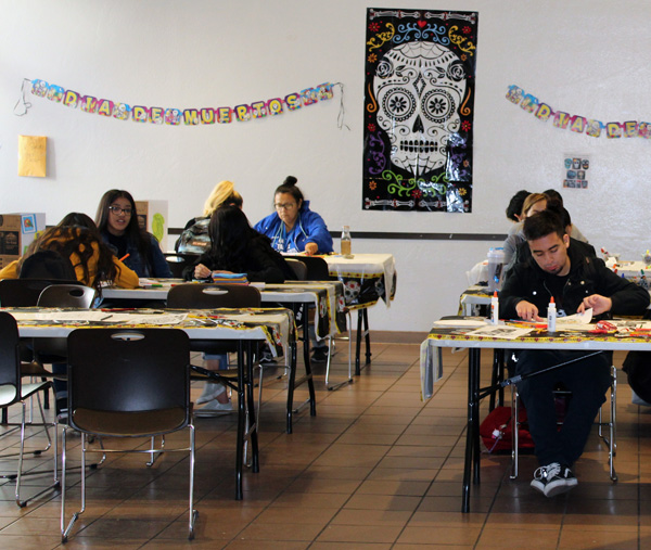 Students participate in the celebration of Dia de los Muertos by stopping by craft stations hosted in lower Danner hall.