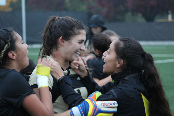 Goalie Amanda Leal celebrates with teammates