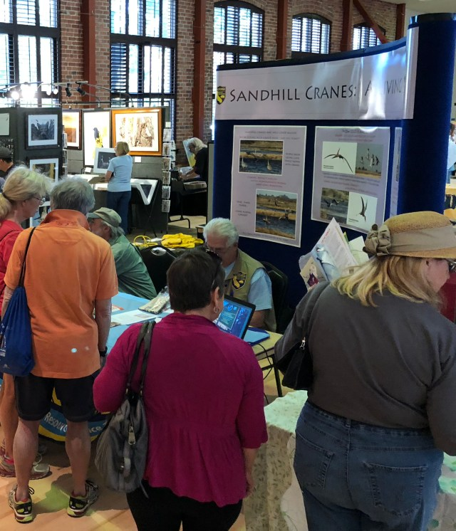 Festival members gather around the exhibit hall to get information about the migration of cranes to the San Joaquin Delta area.