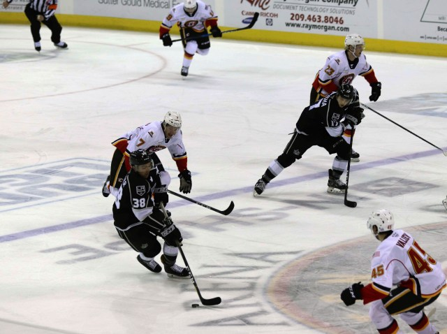 Stockton Heat player #45 Rinat Valiev chasing Ontario Reign player #38 Sam Kurker for the puck during the Harry Potter nights.