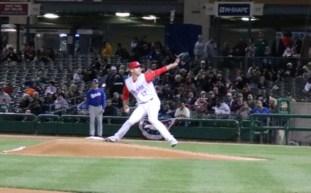 Chris Bassitt throws a pitch during the season opener.