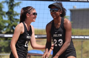 Kelly Markham and Amilya Thompson celebrate after scoring a point. The pair would eventually qualify for the state finals.