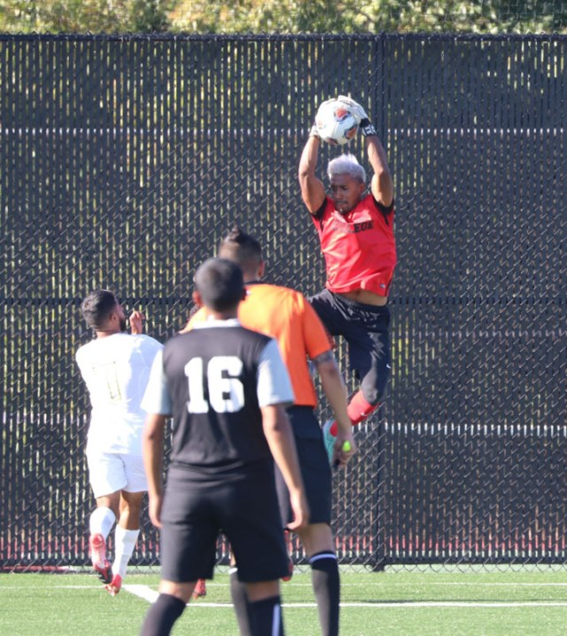 Alexis Jimenez goes up for a save during a 1-0 win over Napa Valley.  Photo by Paul Muyskens
