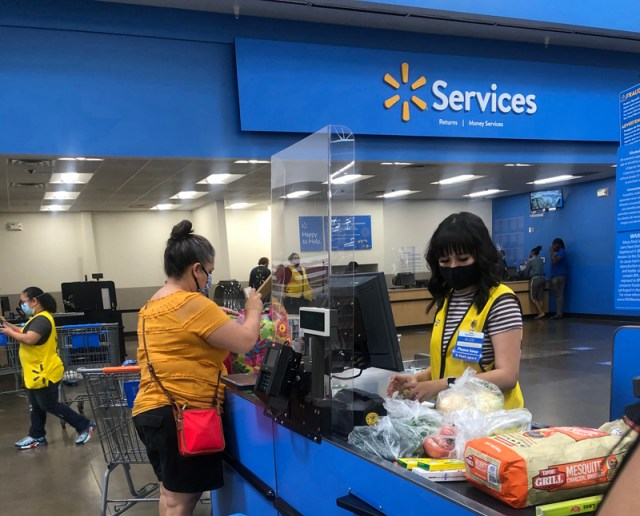 A plastic screen separates a customer from an employee at the Walmart Supercenter at Trinity Parkway in Stockton on. April 26. The screens are intended to ensure safety of all frontline essential workers responding to the COVID-19 pandemic. Photo by Robyn Jones.